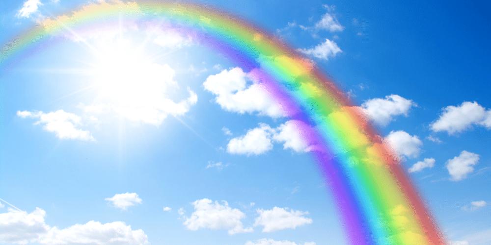 Rainbow against blue sky